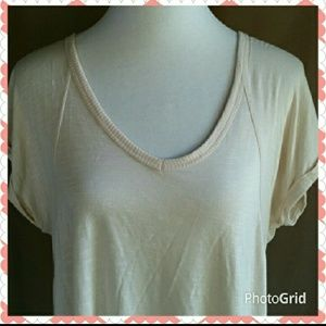 Tops - Cream colored short sleeve t-shirt.